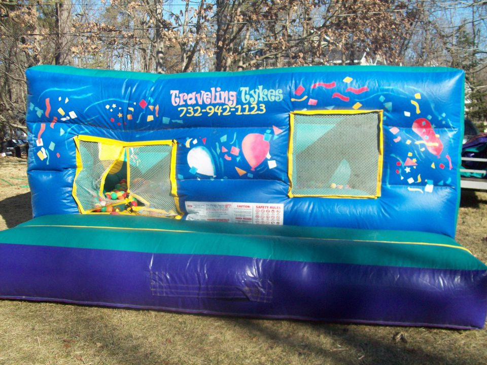 Blown up inflatable moonwalk ball pit rental
