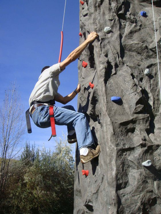 Climber climbing rockwall