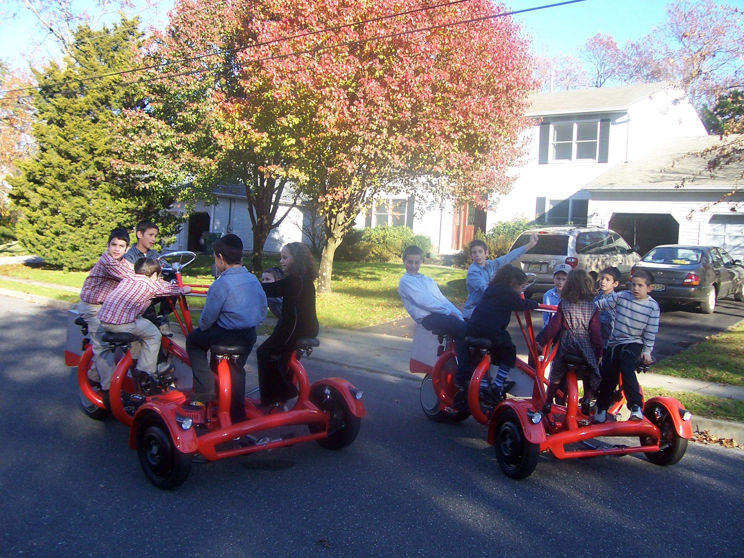 Children Peddling on Conference Bikes
