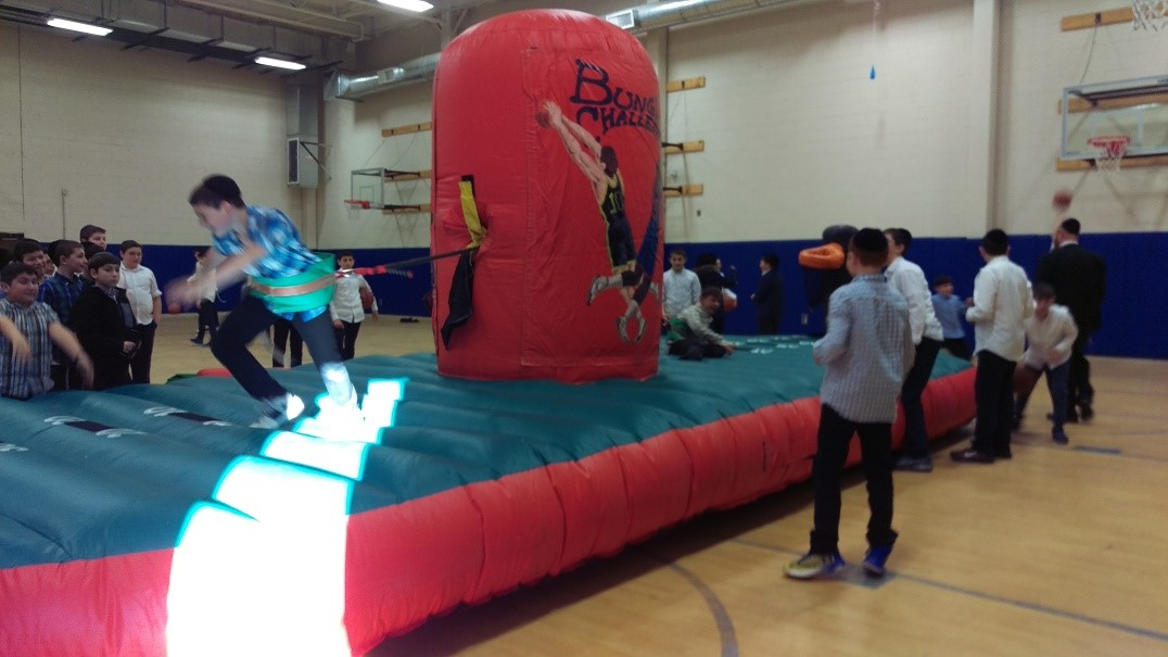 Kids Playing on Inflatable Bungee Challenge Carnival Interactive