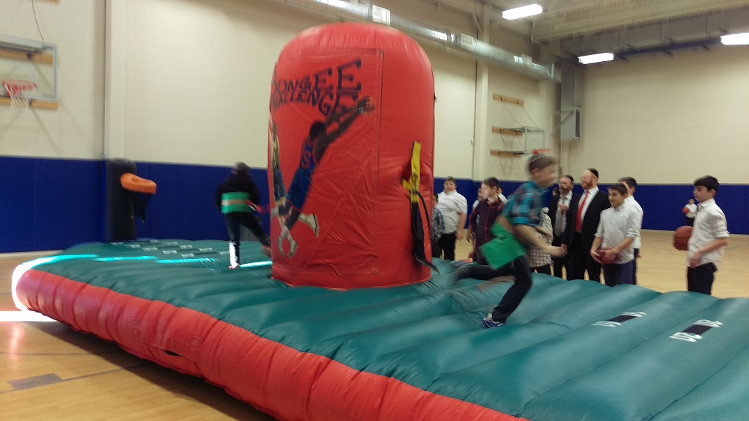 Kids Playing on Inflatable Bungee Tug of War