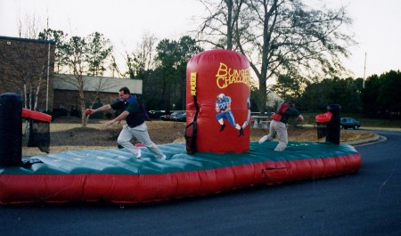 People Playing on Inflatable Bungee Tug of War